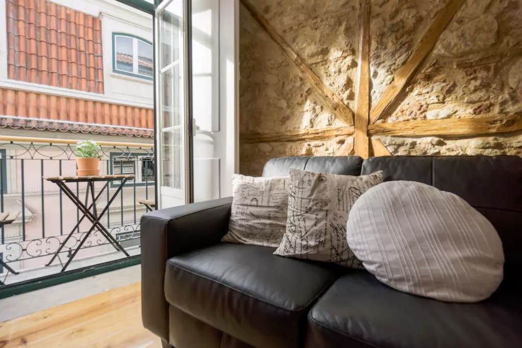 cozy living room with balcony and historic building features