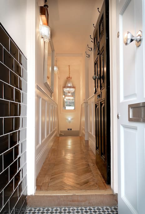 Entrance hallway of property leading down to garden apartment