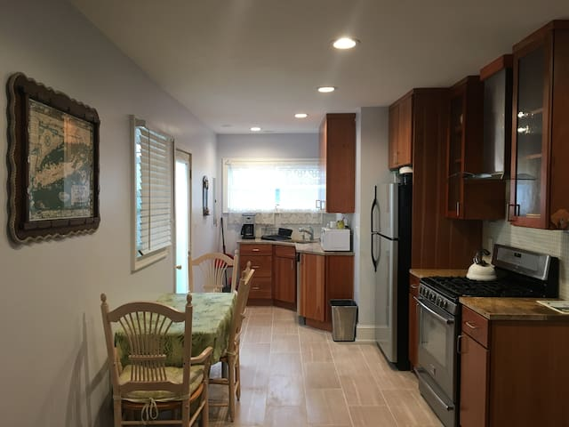 fully renovated kitchen w/ lots of natural light, large windows, tile floors