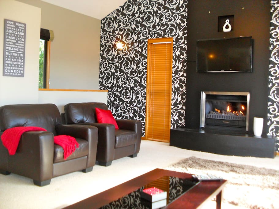 Large comfortable lounge with gas fireplace