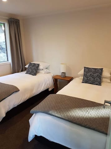 2nd bedroom with 2 king single beds