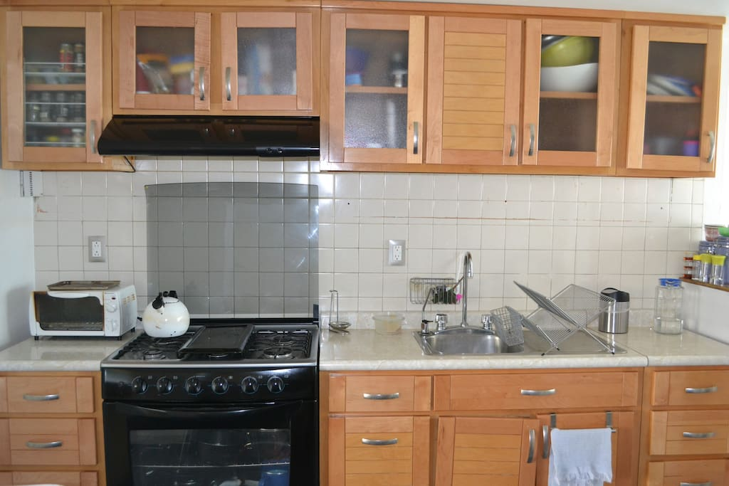 Fully equipped kitchen (toaster, microwave and fully stocked cabinets with dishes, cookware and utensils).