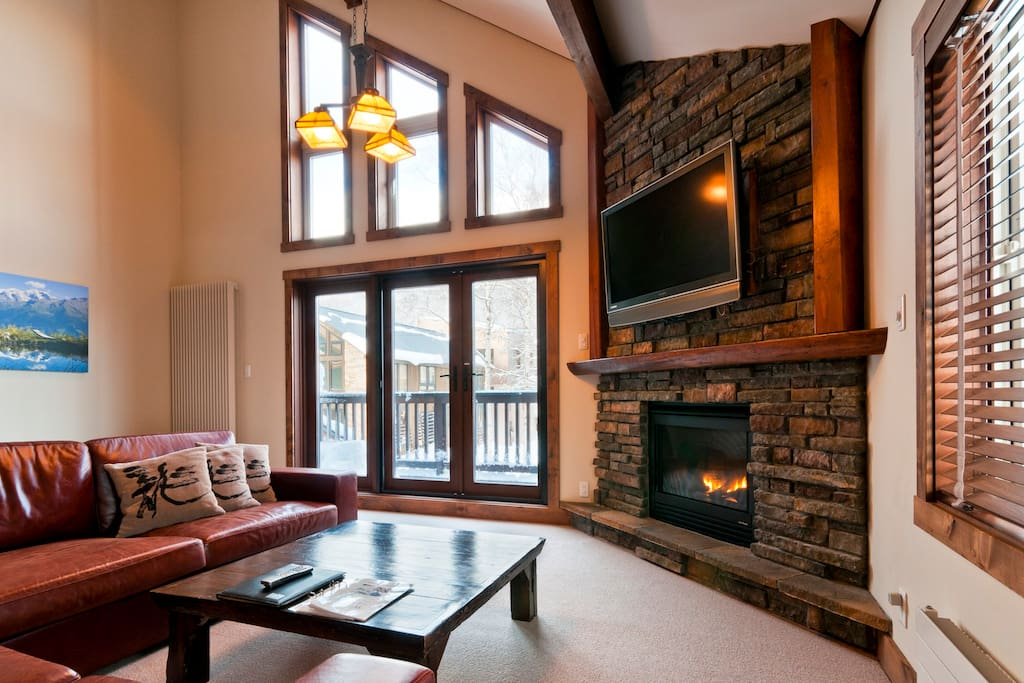 Stone fireplace and flat screen satellite TV (DVD, CD, IPOD connector)