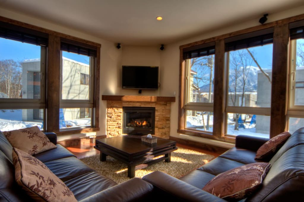 Cosy lounge with stone fireplace and cable TV