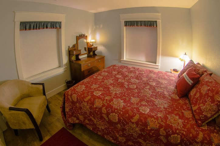 """The """"Sedona Room"""" has a full 5"""" closet with luggage rack, comfortable reading chair and restored antique dresser.  The cordless pleated shades give full privacy.  Custom Queen platform bed."""