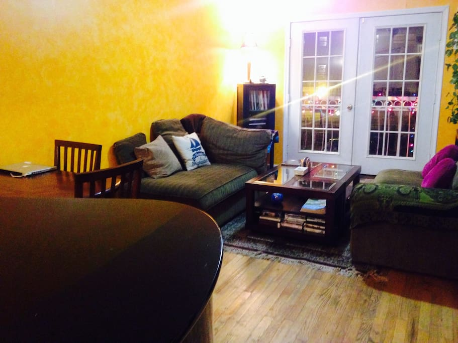Comfy couches, yellow walls in winter and dining tables make socializing easy!