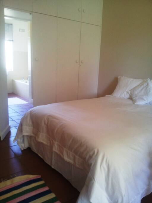 Double bed with fresh white linen bedding