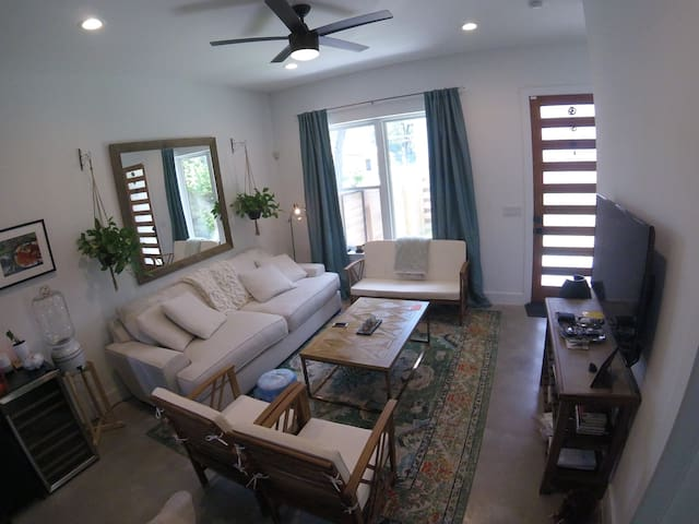 This is the cozy, cute living room. Big couch, TV, WiFi, lots of nice natural light; connects to kitchen space.