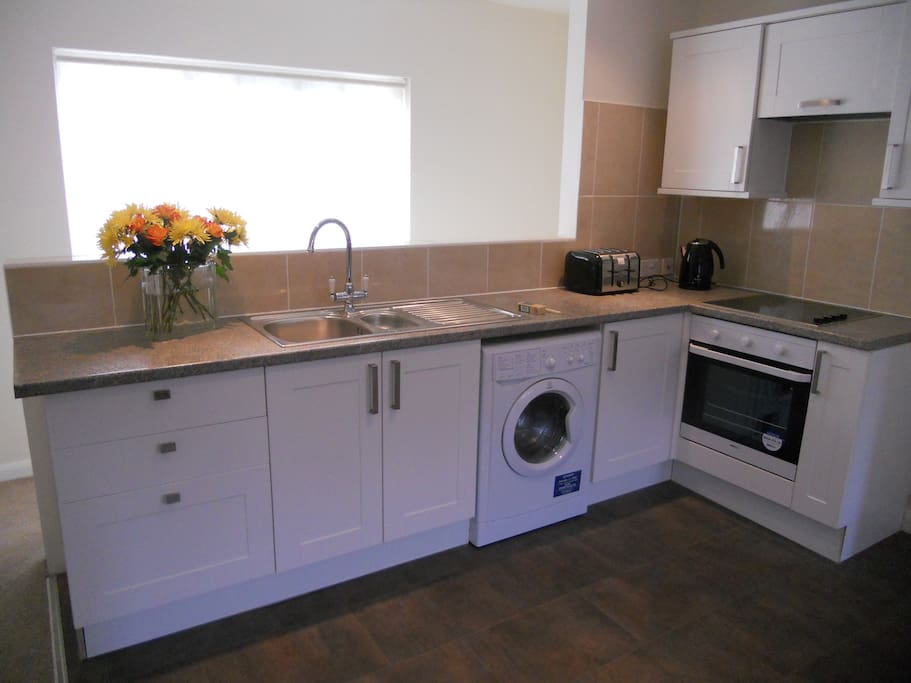 Fully equipped kitchen with hob/oven, microwave, fridge/freezer, all utensils, washer/dryer.