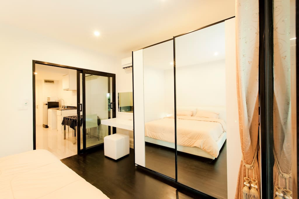 bedroom with mirror wardrobe and king size bed