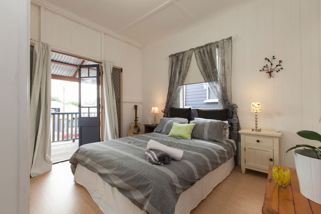 First Queen size bedroom, with french doors opening out onto your own private deck with day bed to watch the world go by