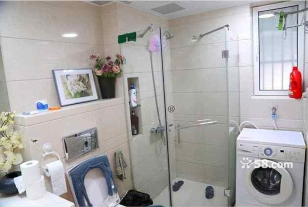 Hotel-styled washroom with front load washer