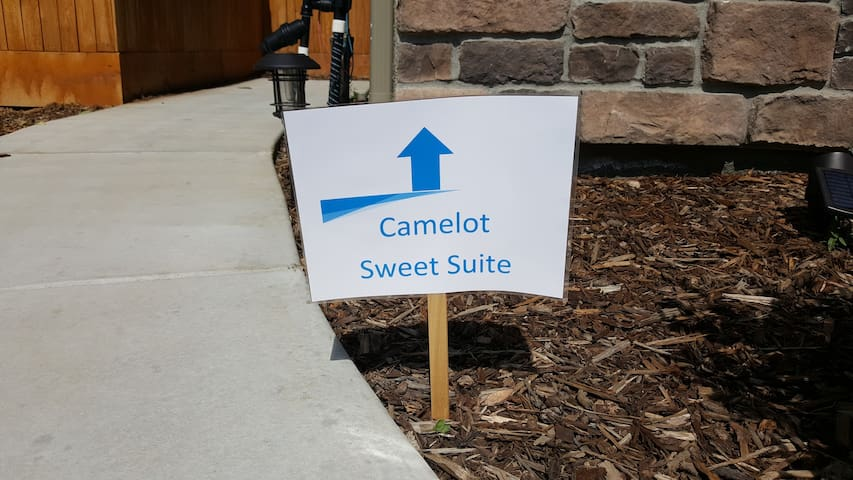 Look for this sign... it will lead you to the entrance door.