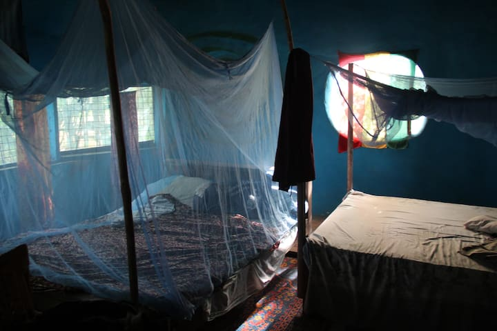Bedroom sleeps up to 4.  Has bathroom annexed.  Small table & chairs, fan & mosquito nets.