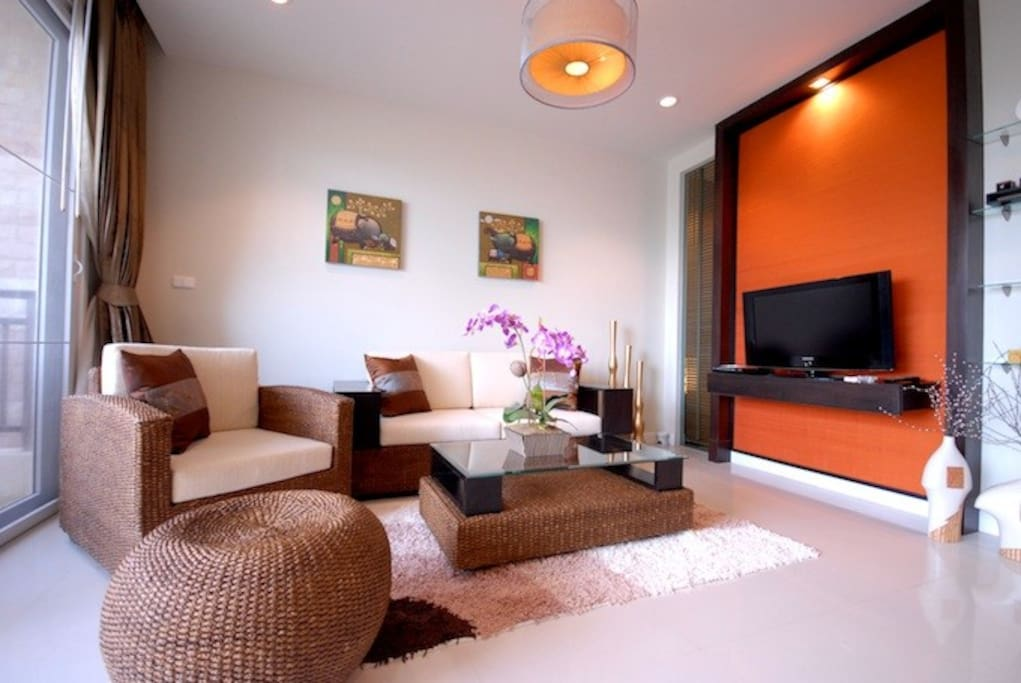 Stylist living room with TV and comfy sofas
