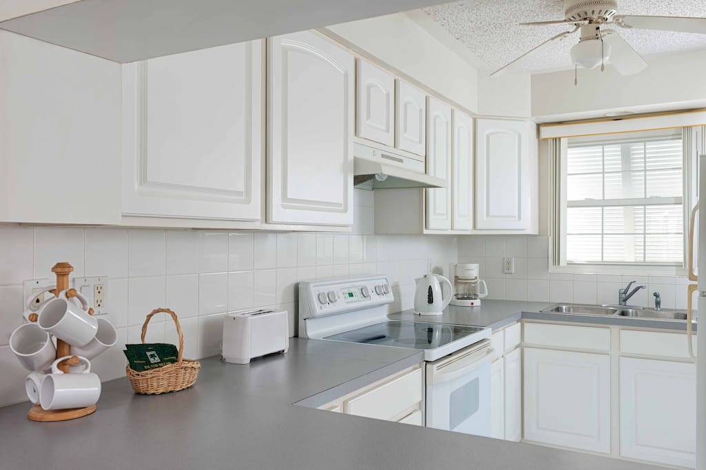 kitchen... features full size fridge/stove, microwave, coffee maker, kettle, toaster.