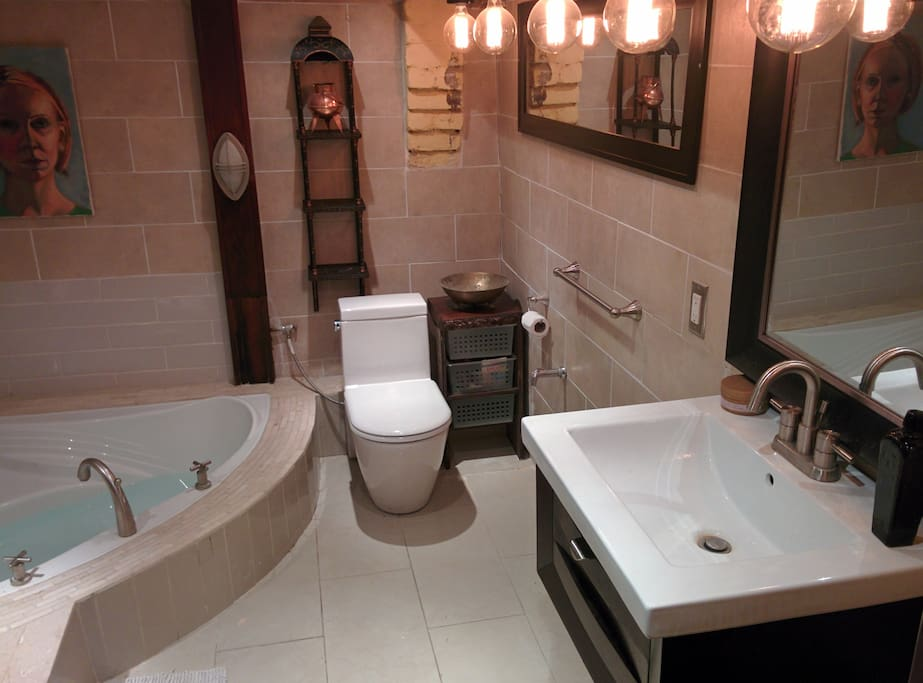 Large bathroom located in the basement with shower and bath.