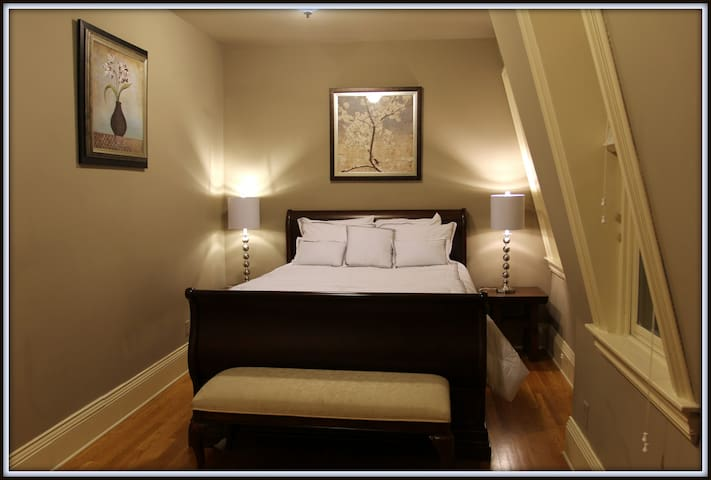 Master Bedroom with queen bed and luxurious bedding.