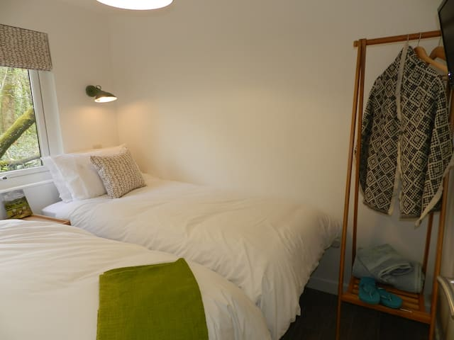 Comfortable twin bedroom at the rear with woodland views. Wall mounted tv.