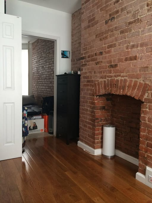 This is the exposed brick non-working fireplace. The dresser will not be there.