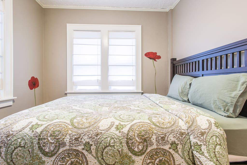 Second bedroom with queen bed and under bed storage.