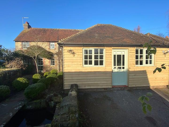 Cosy cabin in idyllic West Sussex village