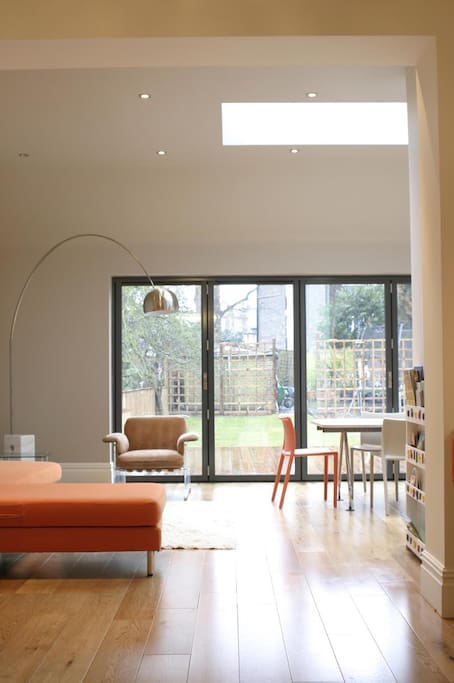 Open plan living and dining area for (8 seats), with 5m of cafe style doors to garden
