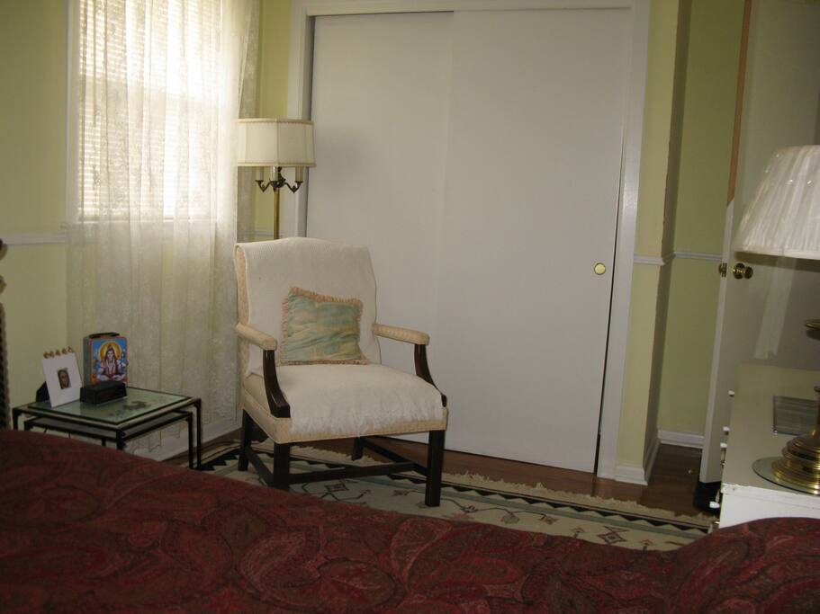 Your cumfy chair & double closet in bedroom
