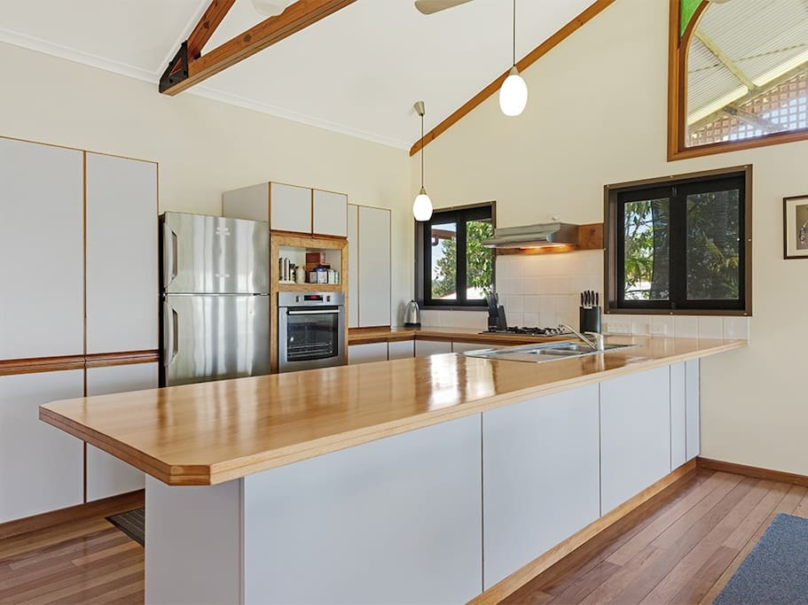 The large kitchen is very well equipped with a full sized fridge, dishwasher, new wall oven, microwave and gas hotplates. We have an expresso machine so you can enjoy a coffee on the deck.
