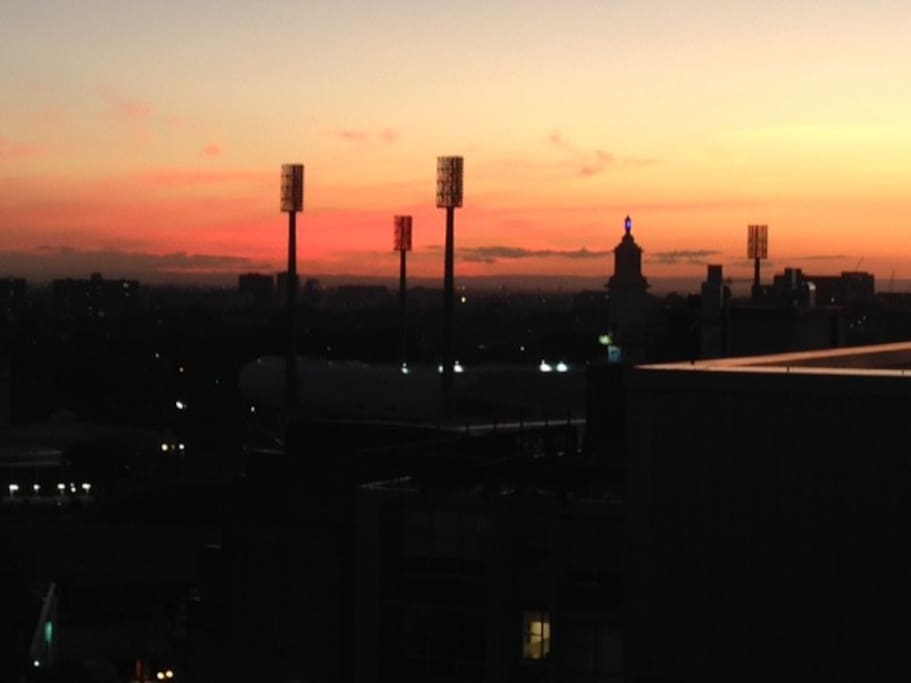 View from balcony looking across sport stadiums (SCG) to another amazing sunset