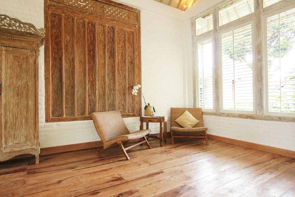 Upstairs. Sit and look out onto the giant Banyan tree.