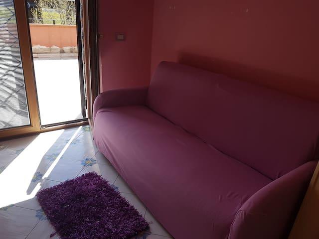 Camera privata con divanoletto