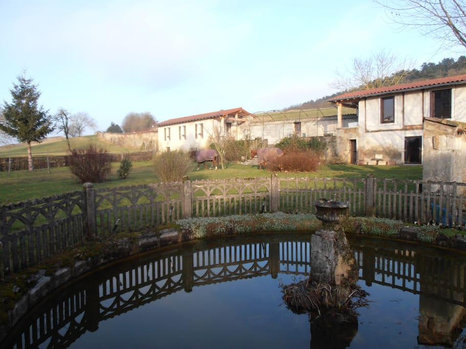 FISH POND AND GARDEN VIEWS. GITE HOUSE TO LEFT OF MAIN HOUSE.