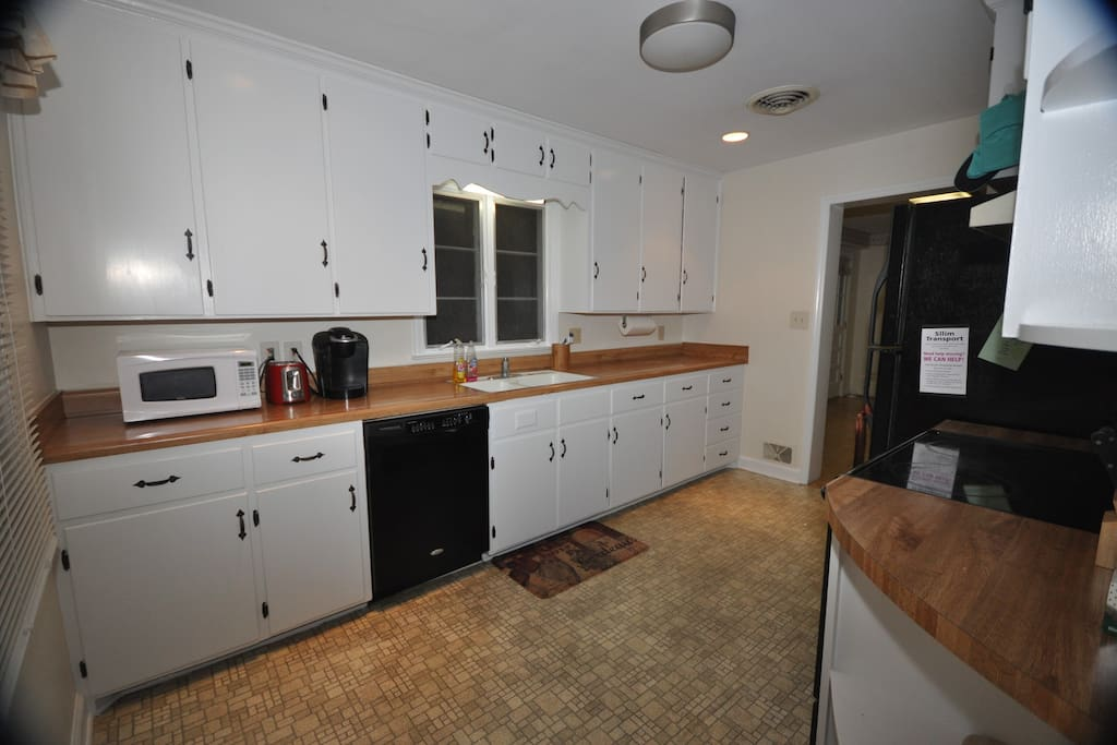 Full fledged kitchen with plenty of separate cabinet space to store your groceries in.