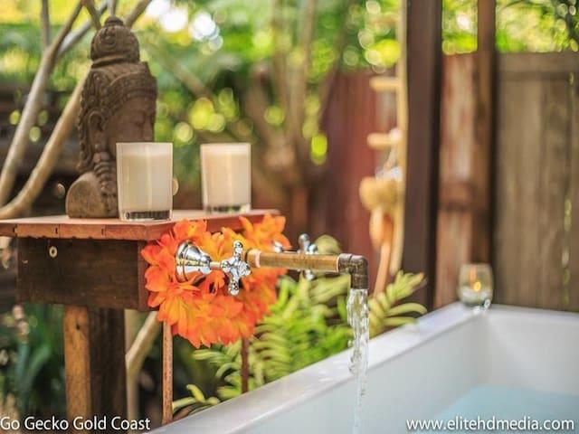 Fancy a bath filled with water hidden away in a secret garden?