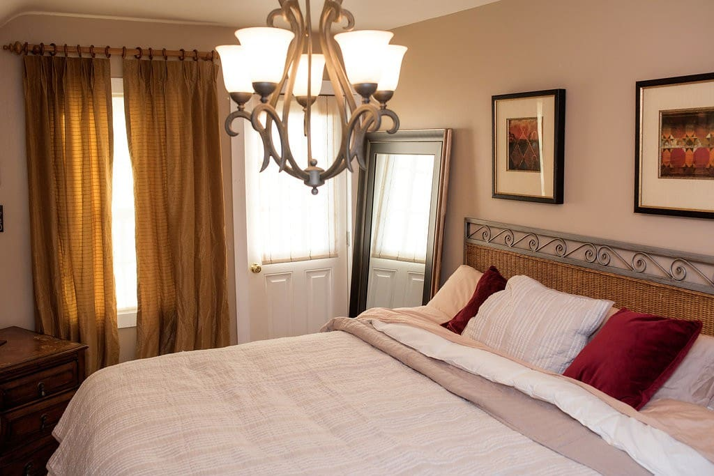 First bedroom: Master with king size bed, private balcony, large walk-in closet, dresser and flat screen TV.