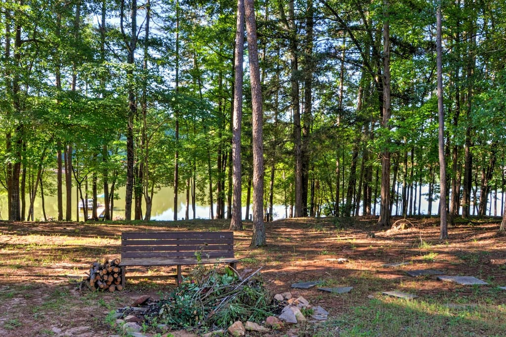 Lake Hartwell and a towering array of trees line the backside of the property.