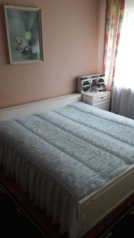 Room with king size bed and wardrobe