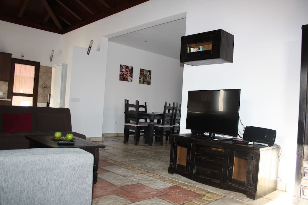 LIVING ROOM,WITH TWO SOFAS,ONE OF THEM BED SOFA.SCREEN TELEVISION OF 42 INCHES, SATELLITE TV ORIENTED SATELLITES ASTRA AND HOTBIRD, HOME CINEMA,