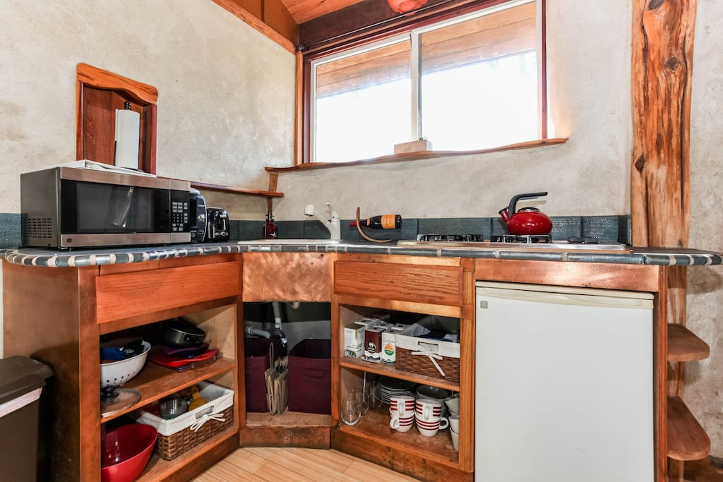 Kitchenette with stove, mini fridge, microwave and coffee maker.  The house is just 2 blocks from a little market with food, wine and anything else you would need.