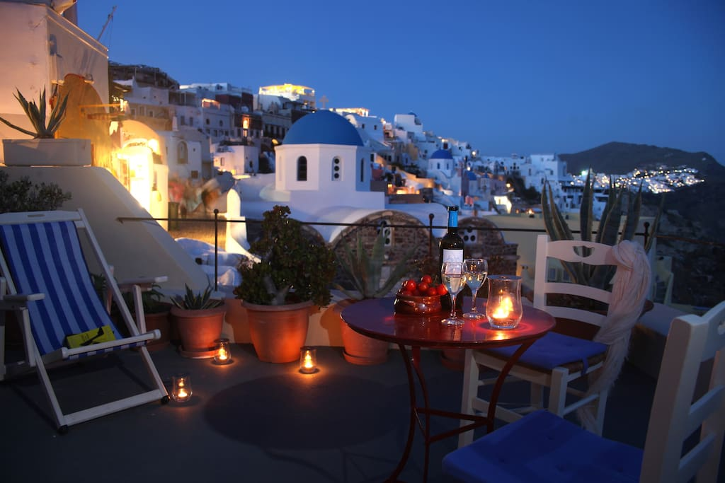 As night falls enjoy a glass of wine on your private terrace...