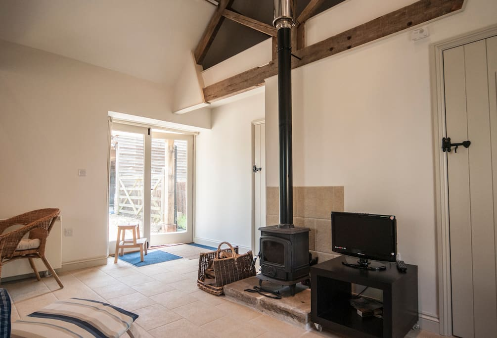 Woodburner and french doors to outside - step free.