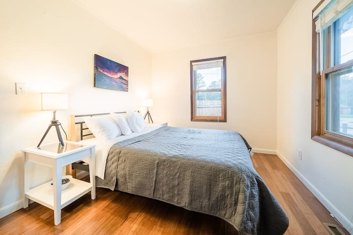 A second bedroom offers a comfy queen bed and lots of light