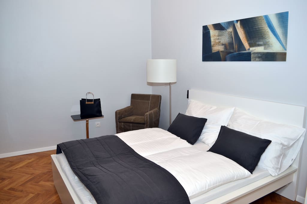 Fisrt bedroom with comfortable double bed