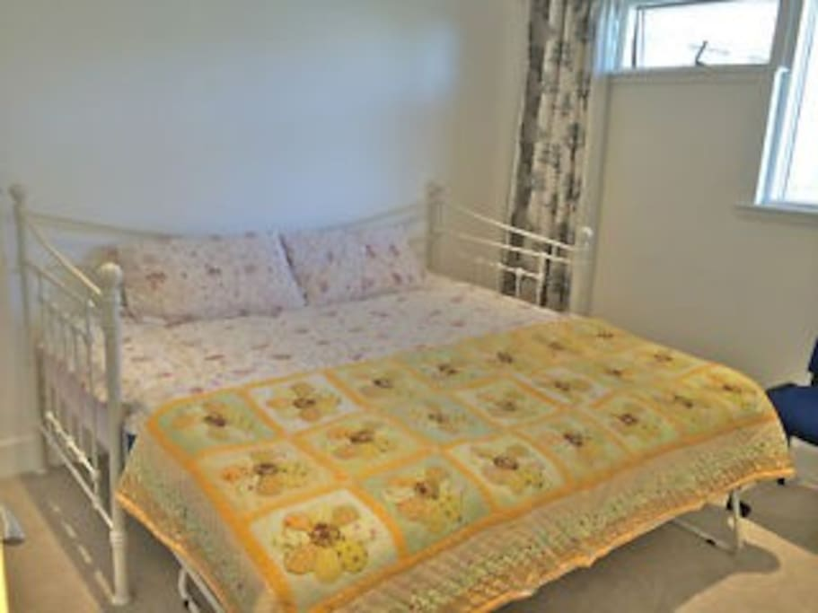 Lovely double bedroom. Very large bed. Built in wardrobes.