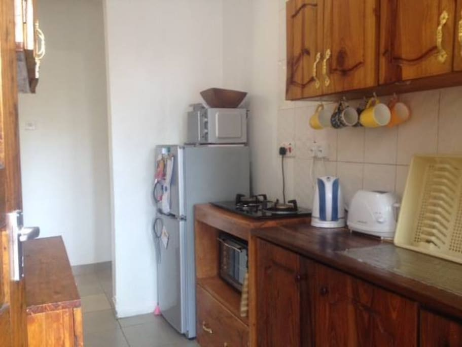 lovely modern kitchen with oven, microwave and gas hobs, fully equipped with plates, pots, utensils etc.