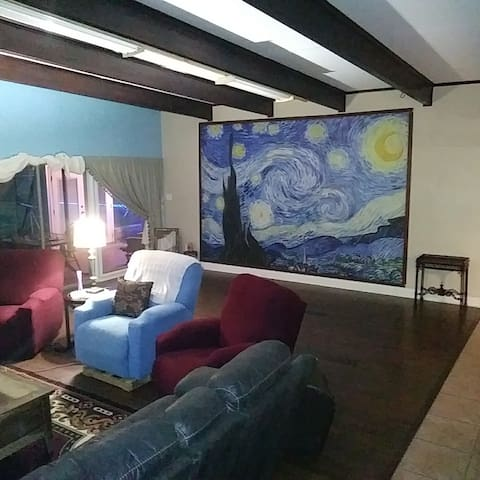 """This is a picture of the """"Stary Night"""" living room with electric recliners, 80 inch LUS cable tv with a PlayStation 3 external USB drive attached for watching movies, videos, etc. and free Amazon Prime access as well."""