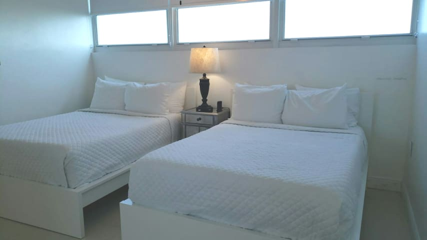 Bedroom with two full size beds