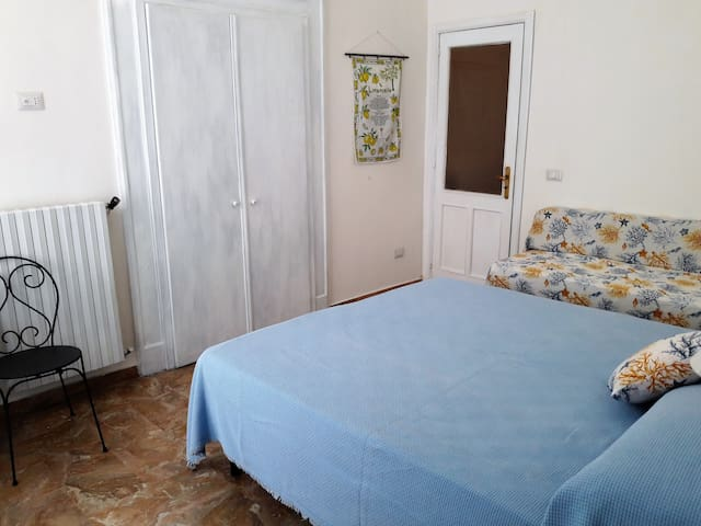 bedroom with exit to a small balcony, there can be 3 single beds or one doublebed + one single