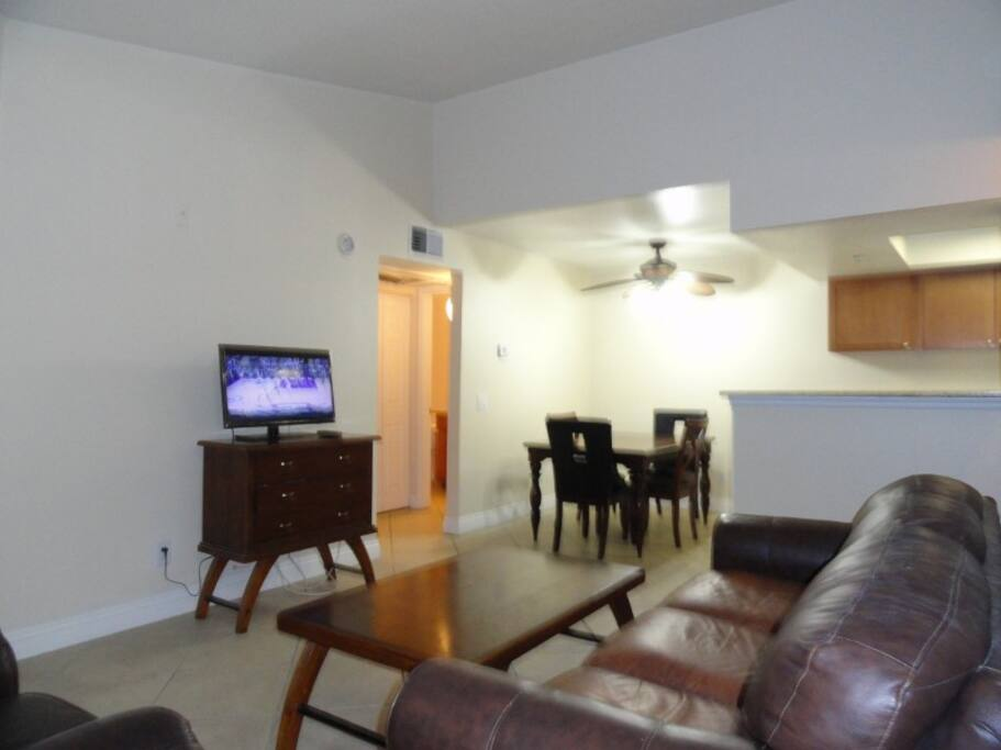 The living room in this top floor unit has vaulted ceilings.
